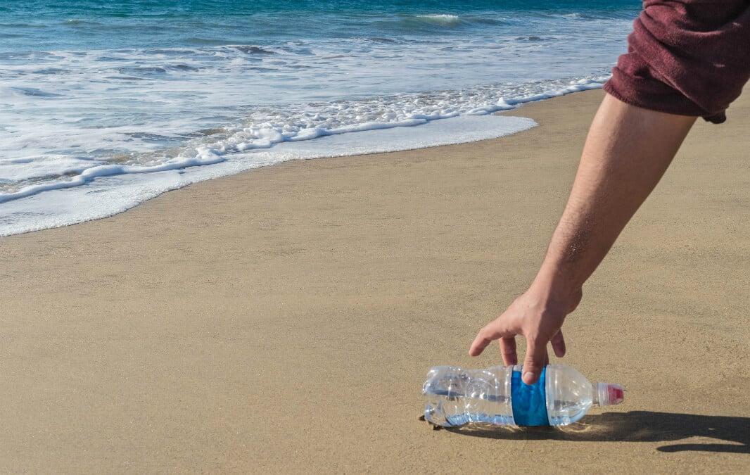 picking up trash at the beach